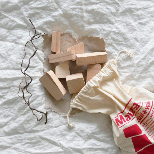 2019 Lessing Mauersack Steine Sack offen 600x600 - Der Mauersack | Holzbausteine